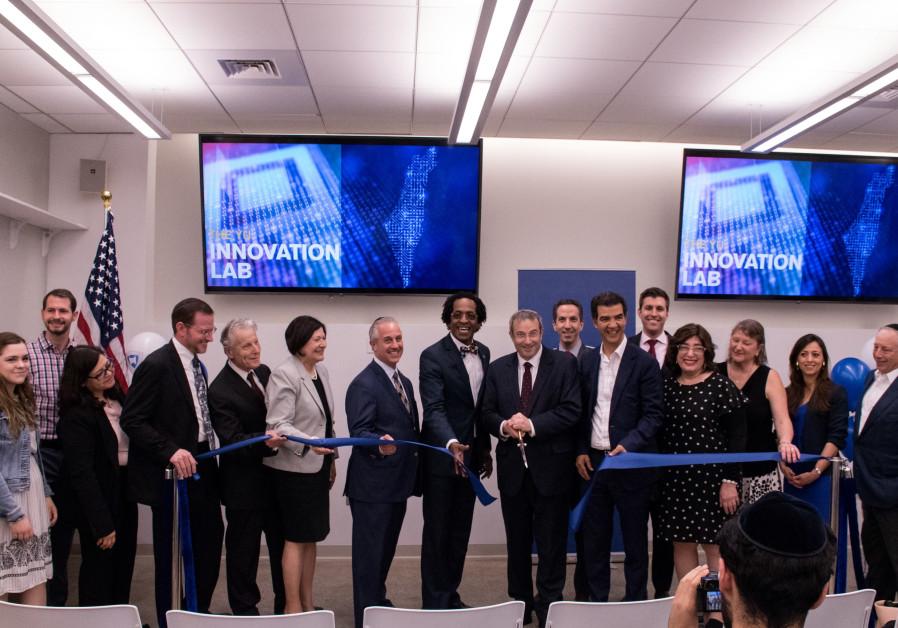 Dignitaries cut the ribbon at the inauguration of Yeshiva University's YU Innovation Lab