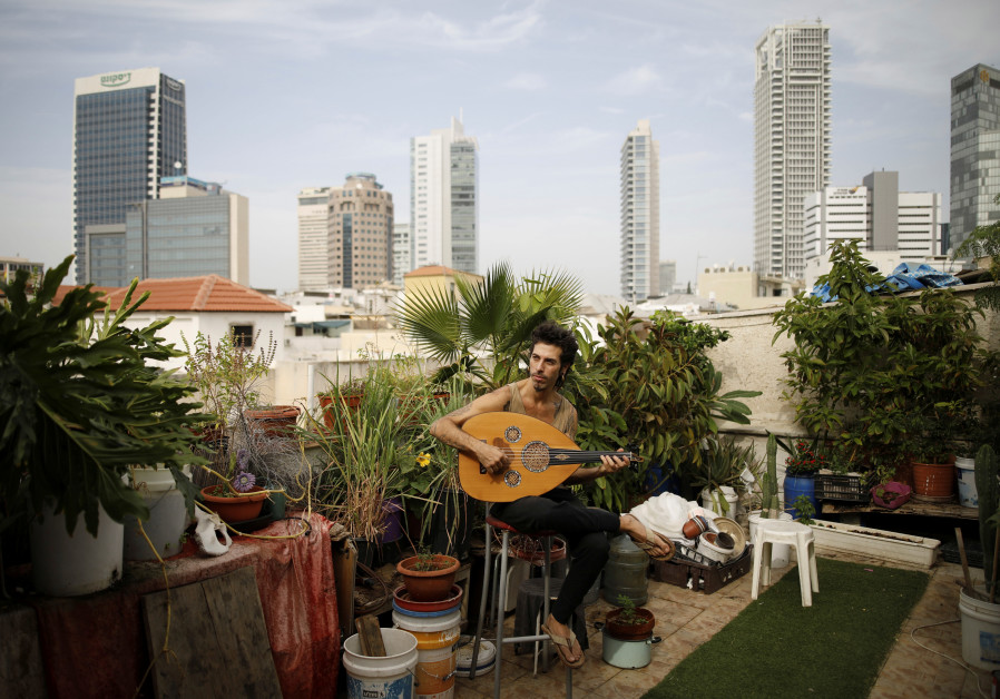 Musician Iyar Semel, 38, on his rooftop garden, where he grows herbs and vegetables, in Tel Aviv. Iy