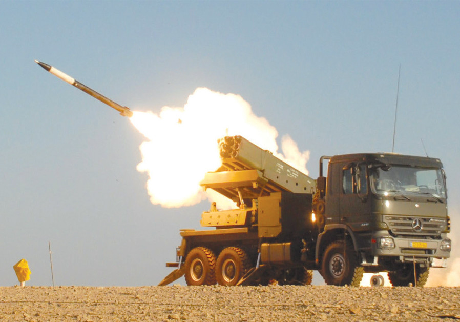 A VEHICLE launches an EXTRA (Extended Range Artillery Rocket Systems) – a precise, low-cost, tactical-range 306mm. artillery rocket system (30 to 150 km. range) in use by several armies around the world. (Credit: ELBIT SYSTEMS)