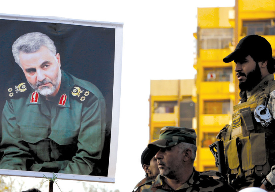 A PORTRAIT of Quds Force Commander Qassem Suleimani is held up during a demonstration in support of Yemen's Shi'ite Houthis, in Baghdad in 2015. (Credit: REUTERS)