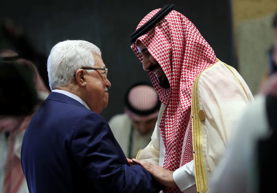 Saudi Arabia's Crown Prince Mohammed bin Salman greets Palestinian President Mahmoud Abbas