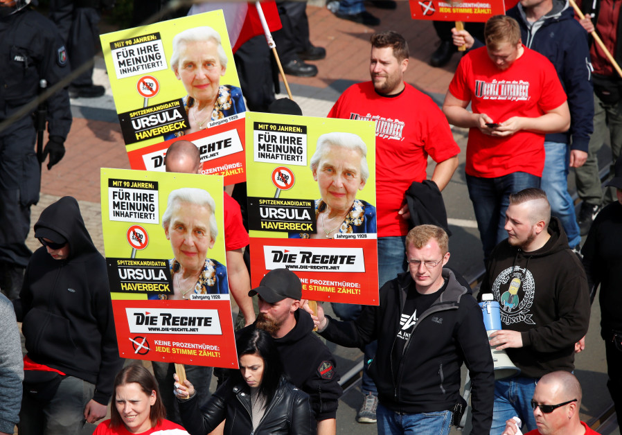 "Far-right supporters of the party ""Die Rechte (The Rights) carry placards of 90-year-old Ursula Have"
