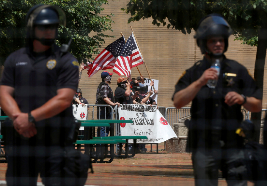Members of the white nationalist group the Honorable Sacred Knights of the Ku Klux Klan hold a rally