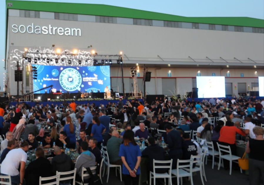 Jews, Muslims and Christians share an iftar meal at the SodaStream facility in Israel's southern Negev region. Credit: Sivan Faraj