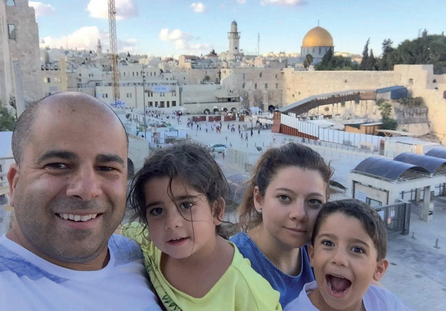 Shalicar with his family at the Western Wall in Jerusalem