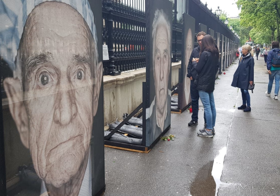 Photos of the exhibit in Vienna on Tuesday as activists gathered to protect it from vandalism