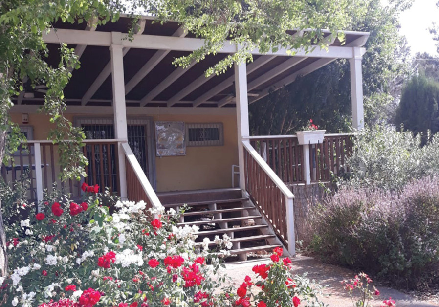 The cafe and flowerbeds at the entrance to the moshav miraculously survived intact (Credit:Liane Grunberg)
