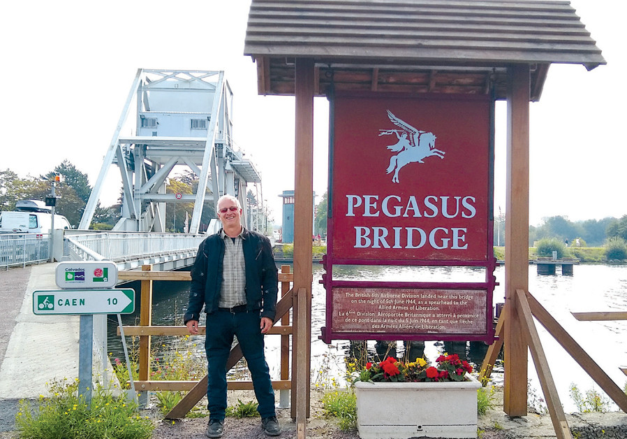 THE WRITER at the famous Pegasus Bridge, captured by the British on D-Day. (Credit: BRIAN JABLON)