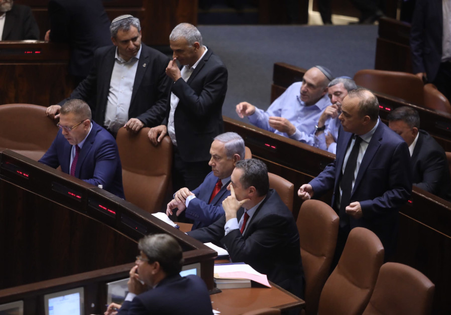 Prime Minister Benjamin Netanyahu sitting in the Knesset before the vote on Knesset dispersal.
