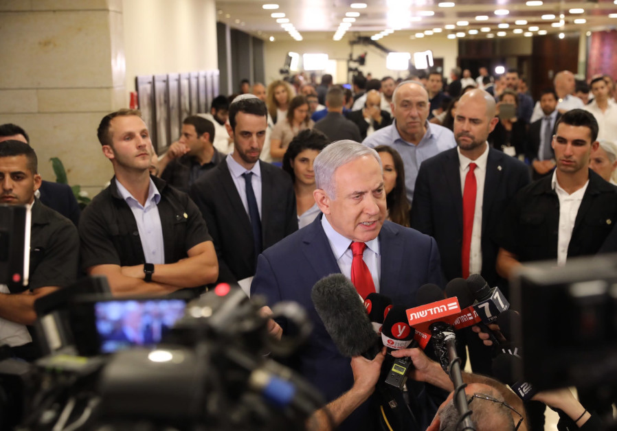 Prime Minister Benjamin Netanyahu speaks with the press following the vote for Knesset dispersal.