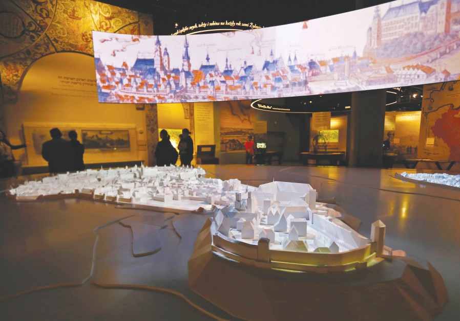 PEOPLE VISIT an exhibition near a model of Krakow city at the POLIN Museum of the History of Polish