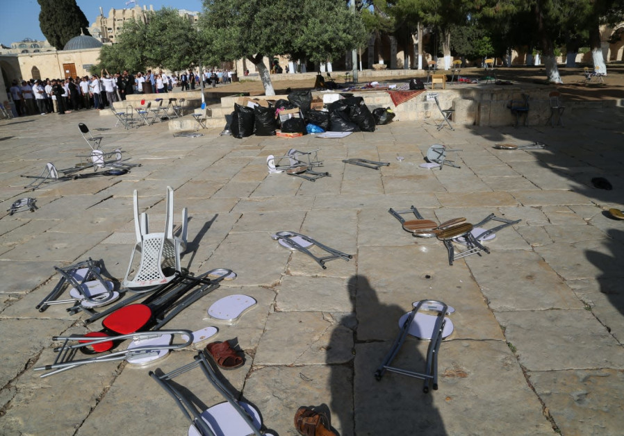 Chairs and objects thrown on the ground after Arabs rioted the decision to allow Jews to enter the T