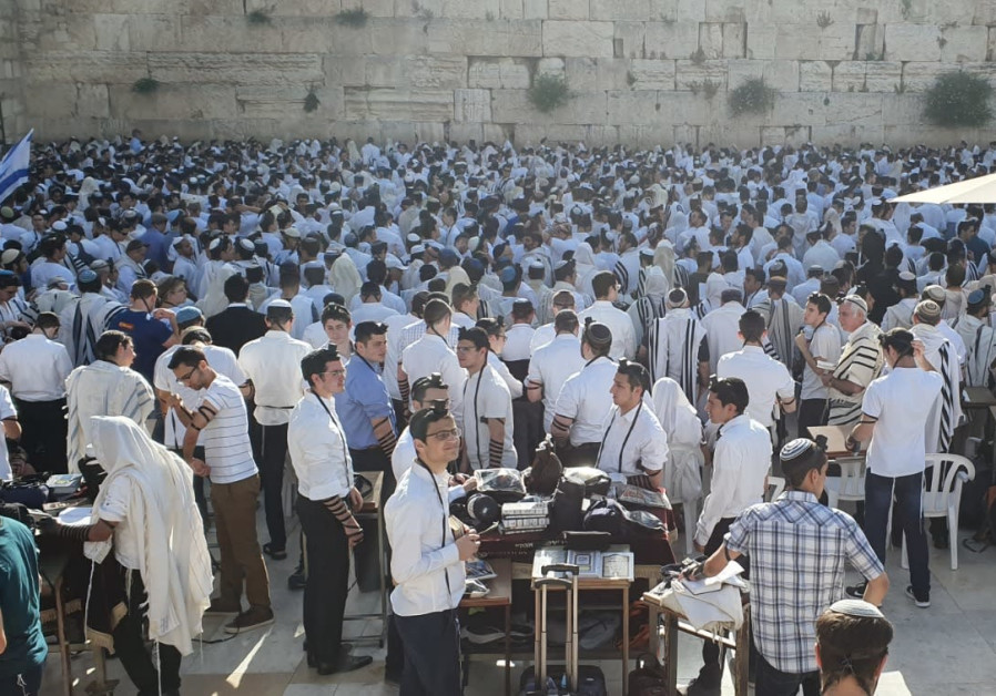 Thousands flock to the Western Wall in a festive morning prayer to mark Jerusalem Day