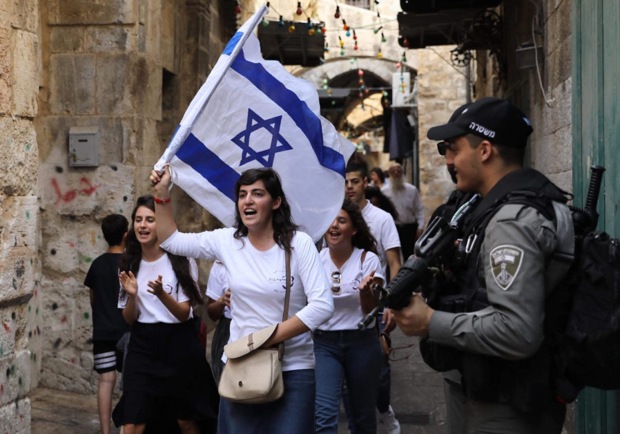 Jewish women march while police patrol in the Old City during Jerusalem Day, 2019