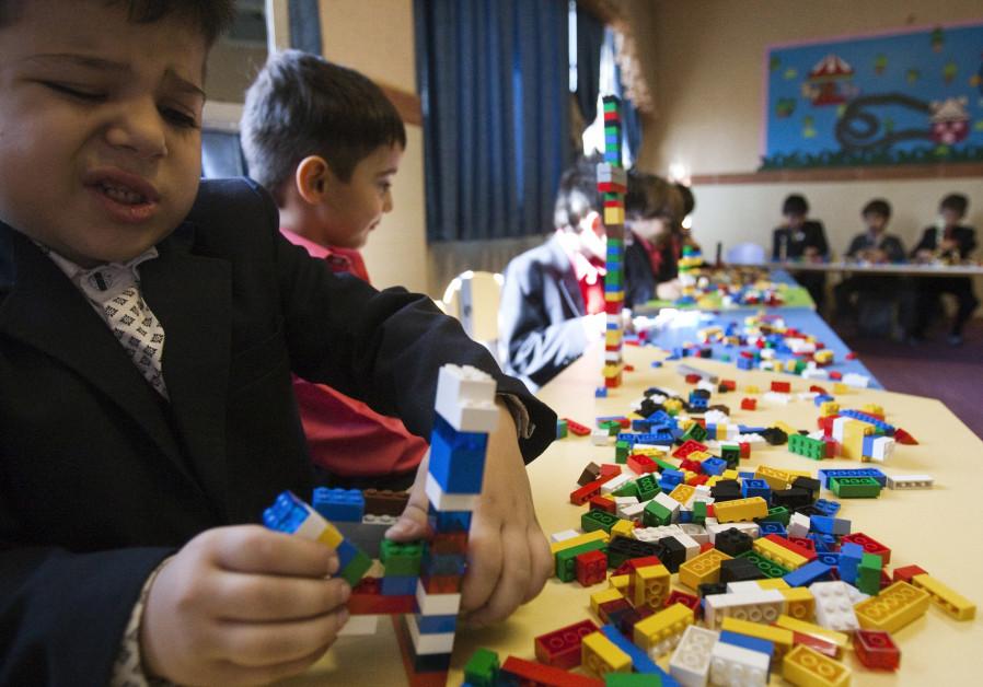 Students play with Lego bricks in the Pishtaz School in Tehran October 2011