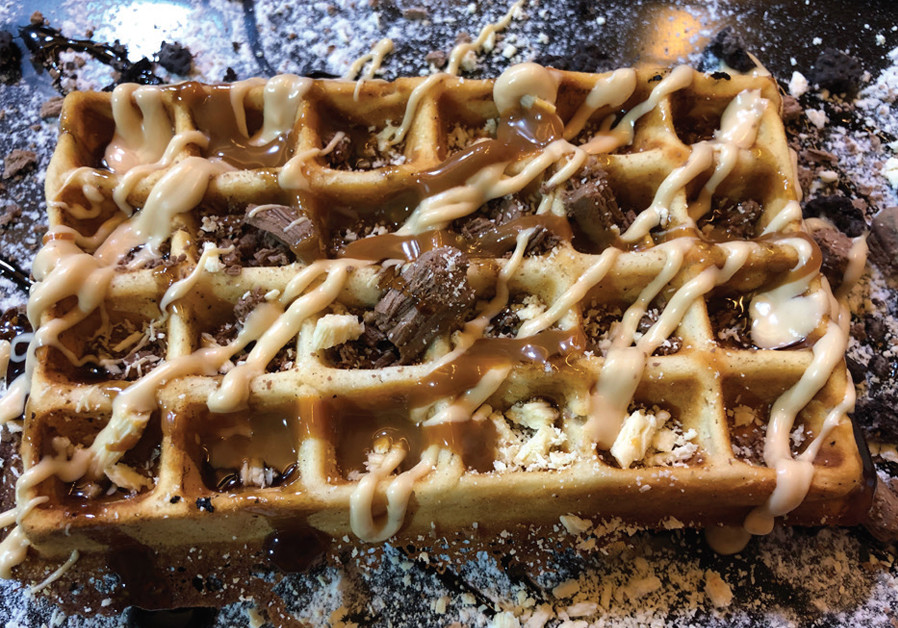 AMONG THE hot desserts: A fluffy Belgian waffle with chocolate sauce. (Credit: MAAYAN HOFFMAN)