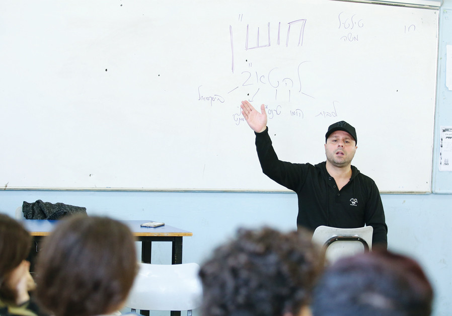 LIRON 'TILTIL' ORFALI speaks to Herzliya Gymnasium students on behalf of Hoshen. (Credit: ALONI MOR)