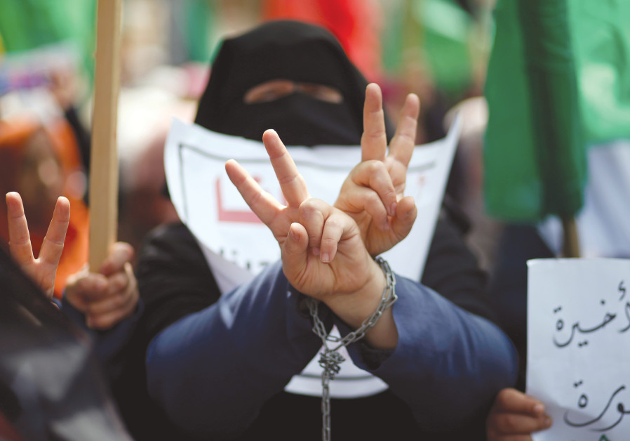 A PALESTINIAN woman protests for Palestinian prisoners