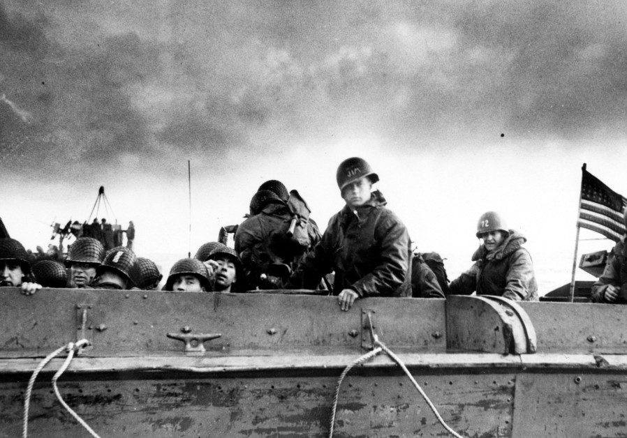U.S. Army troops and crewmen aboard a Coast Guard manned LCVP approach a beach on D-Day in Normandy
