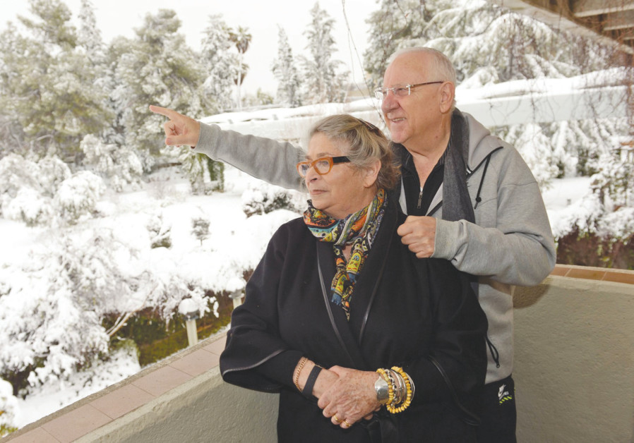 PRESIDENT REUVEN Rivlin and his wife, Nechama, enjoy the beauty of Jerusalem in the snow in February