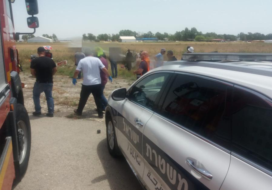 Medics and police crowd around the site of a glider crash near Megido Airport in Emek Izrael.