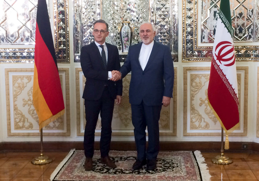 Iranian Foreign Minister, Mohammad Javad Zarif shakes hands with his German counterpart Heiko Maas a