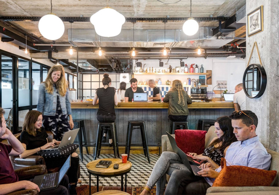 Why are major corporations moving into Israel's coworking spaces?