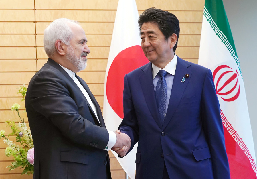 Iranian Foreign Minister Mohammad Javad Zarif, left, and Japanese Prime Minister Shinzo Abe, right,