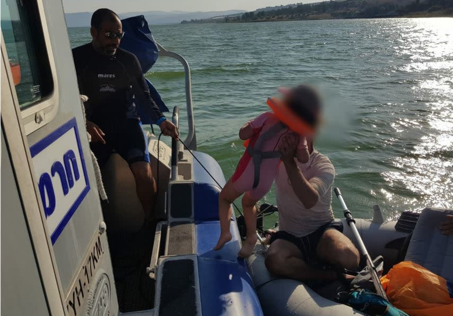 Police rescue a stranded boat on the Sea of Galilee, June 10 2019