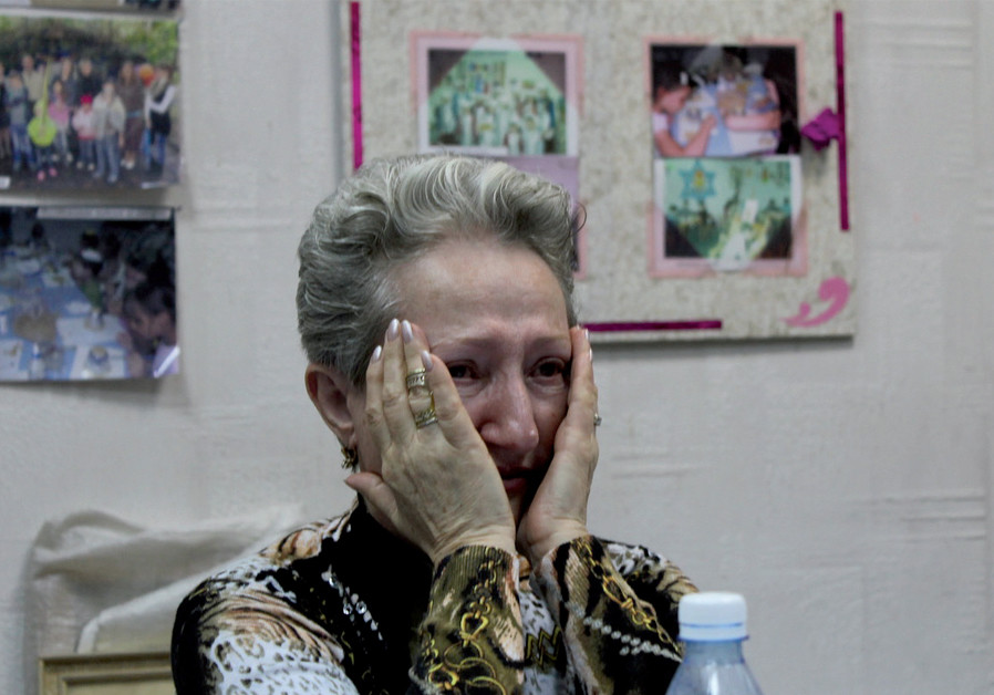A Jewish woman displaced by the fighting cries as she recounts her escape from Donetsk (Credit: SAM SOKOL)