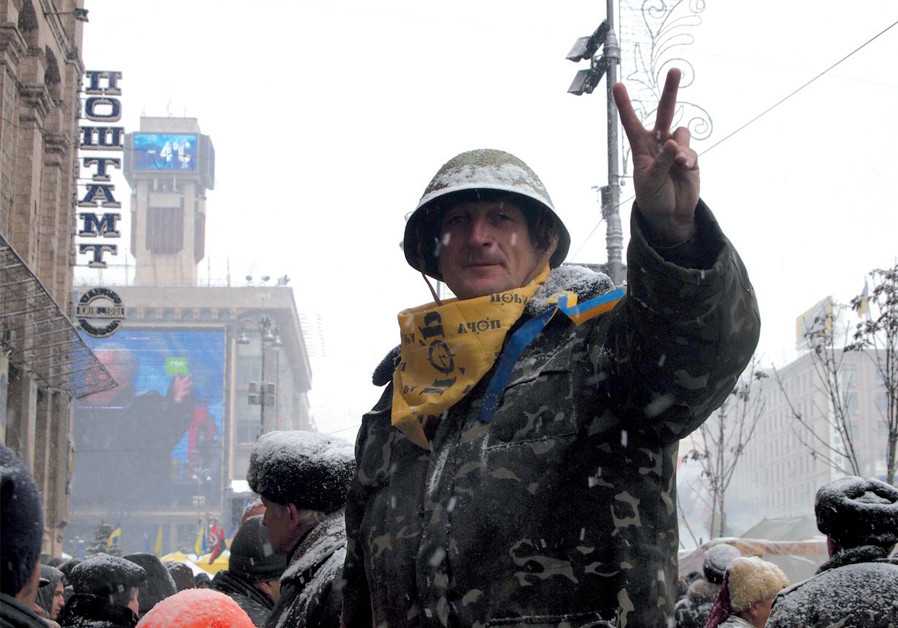 A Ukrainian protester gives the victory sign during the 2013 Euromaidan revolution (Credit: SAM SOKOL)
