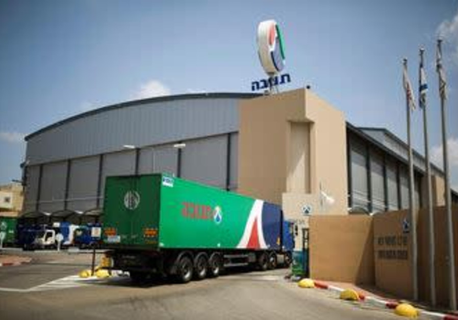 A Tnuva truck enters the company's logistic centre in the southern town of Kiryat Malachi, Israel Ma