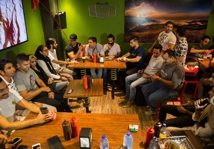 Iranian young people gather at a restaurant in west Tehran
