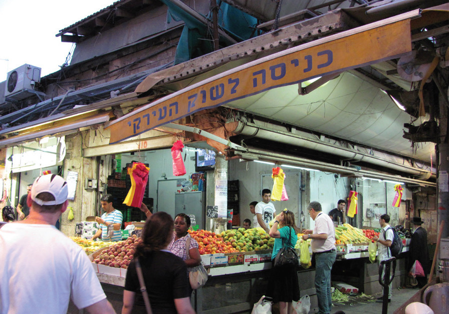 'FOR YEARS, Mahaneh Yehuda was the beating heart of the city, with clear-cut rules.' (Credit: Wikimedia Commons)