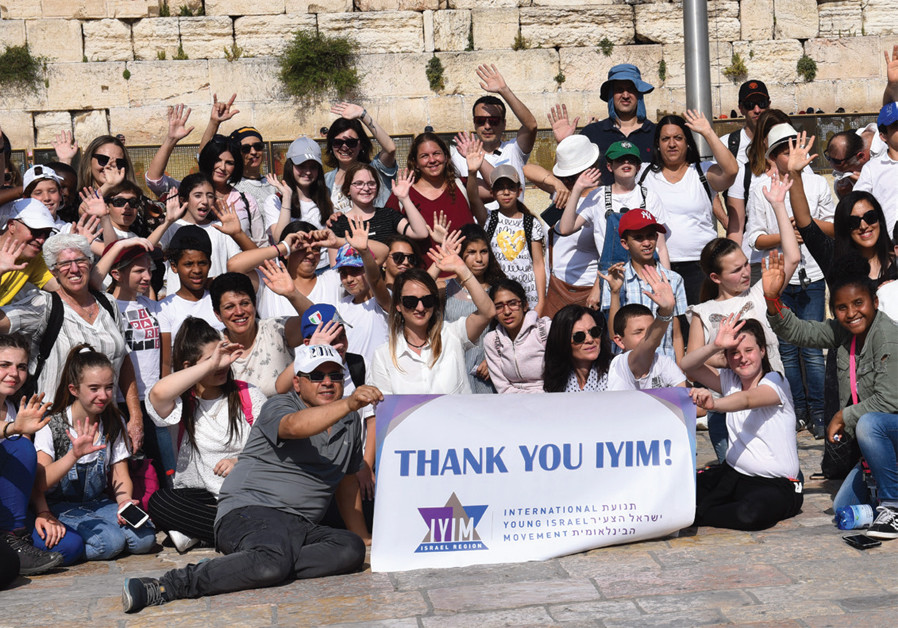 DESPITE HIS own bar mitzvah struggles, Ridloff joined over 100 deaf and hearing-impaired children at a bar and bat mitzvah celebration at the Western Wall. (Credit: NACHSHON PHILIPSON)