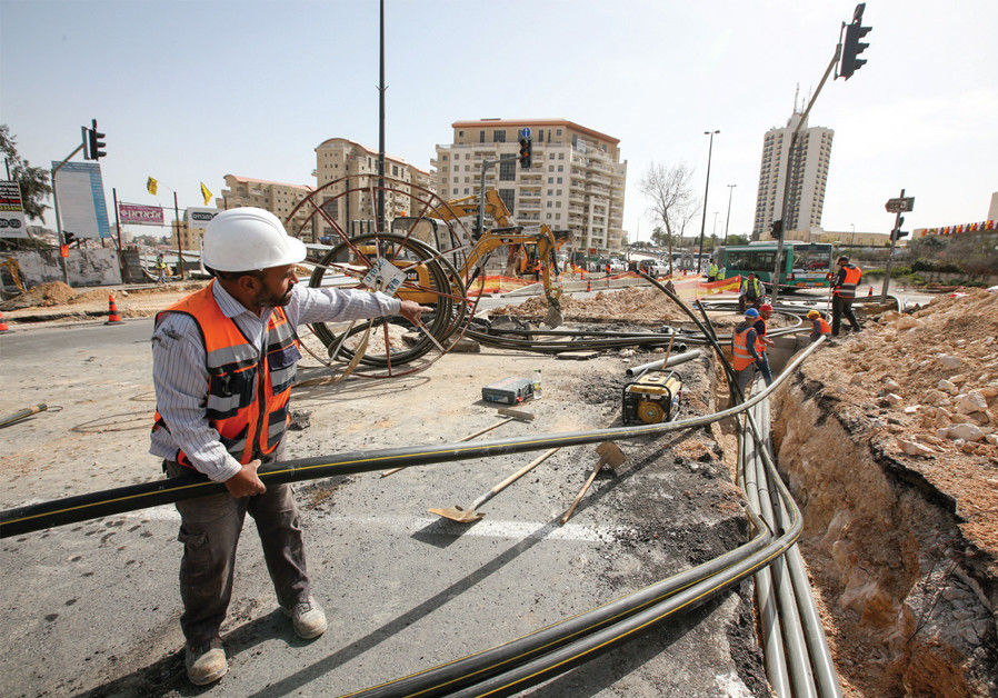 HARD AT work at the entrance to Jerusalem. (Credit: MARC ISRAEL SELLEM)
