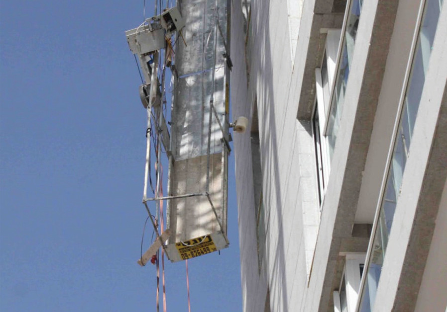 SHMULIK ZYLBERMAN died in 2012 when the scaffolding elevator at this Netanya site detached and plunged downward. He wasn't wearing a safety belt. (Credit: Courtesy)