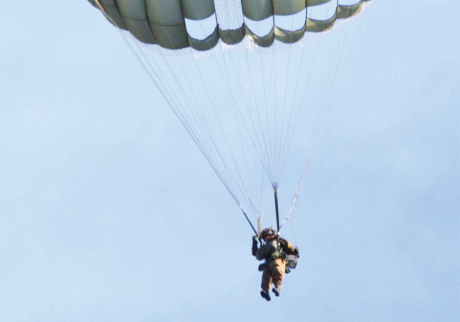 UNDER HIS parachute: The writer takes to the air during the course in Denison, Texas. (Credit: MARK GRANAT)