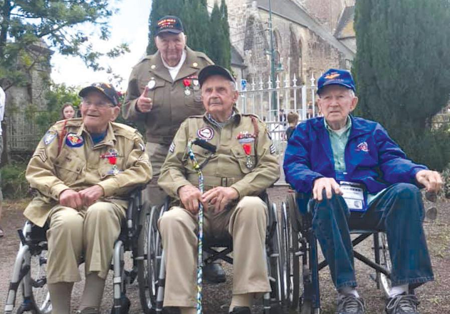 LIBERTY JUMP Team's four veterans in Set-Mer-Eglise: (left to right) Bob Noody (506PIR, 101Abn); George Merz (818th MP); Dan McBride (502PIR, 101Abn); and Bill Van Osdol (US Navy).( Credit: PETER PLANK)