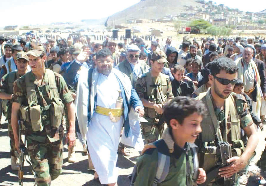 MOHAMMED ALI AL-HOUTHI (center), head of the Houthi Supreme Revolutionary Committee, surrounded by children as shields. (Credit: MINISTRY OF INFORMATION - REPUBLIC OF YEMEN)
