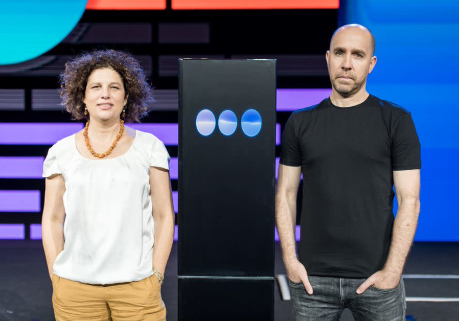 Dr. Ranit Aharonov (L) and Dr. Noam Slonim (R) with IBM's Project Debater – Speech by Crowd machine