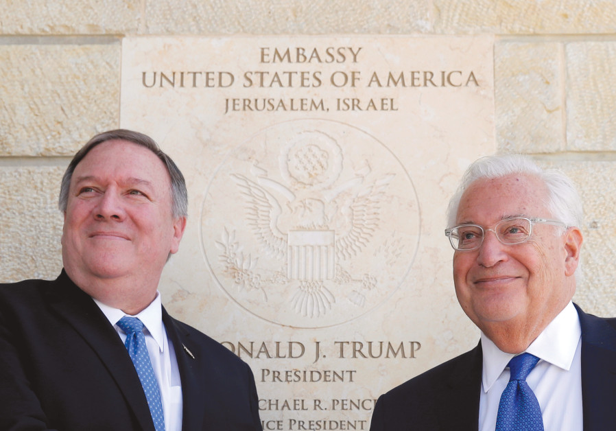 US SECRETARY OF State Mike Pompeo and US Ambassador to Israel David Friedman stand next to the dedic