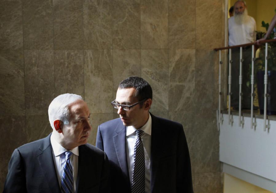 Former cabinet secretary Zvi Hauser and Prime Minister Benjamin Netanyahu.