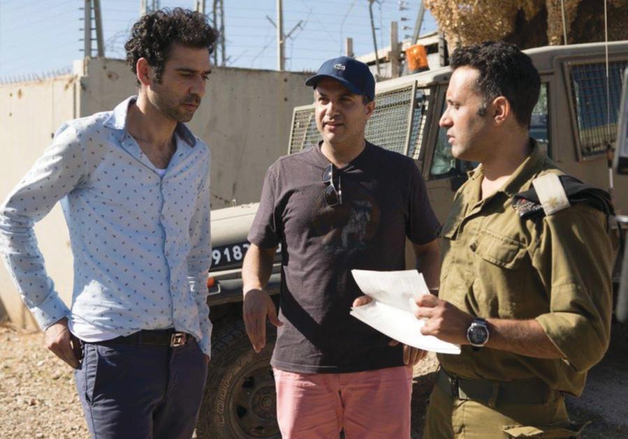 'TEL AVIV ON FIRE' director Sameh Zoabi (center) with actors Kais Nashif (left) and Yaniv Biton