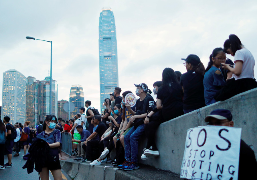 Protesters attend a demonstration demanding Hong Kong's leaders to step down and withdraw the extrad