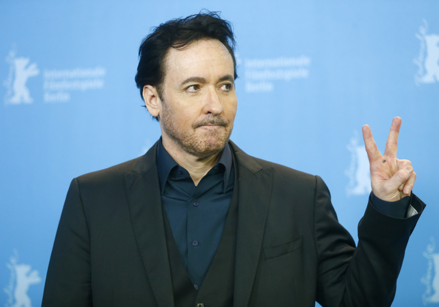 Actor John Cusack poses during a photocall to promote the movie 'Chi-Raq' at the 66th Berlinale Inte