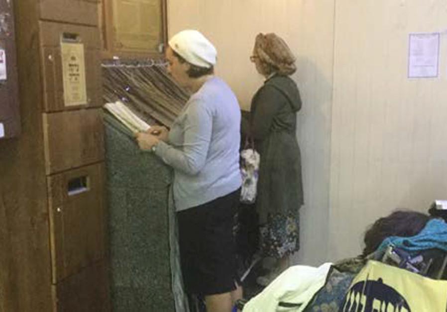 PRAYING AT the grave of Rabbi Nachman. (Credit: CAROL UNGAR)