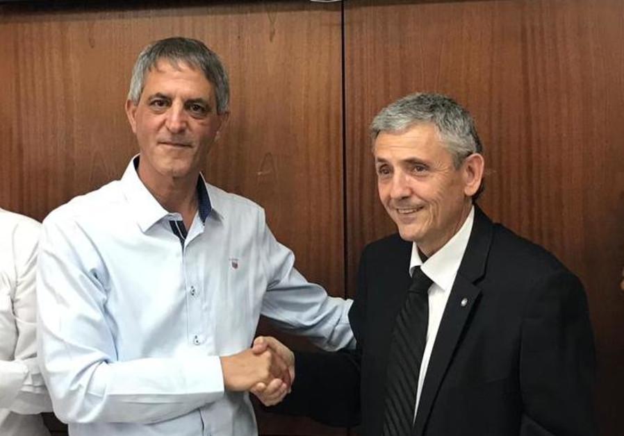 Avi Himi (left) won the election as the Israel bar association's president