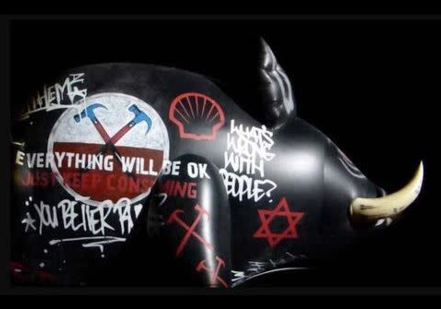 An inflatable pig with a Star of David painted on it was displayed during a Roger Waters performance of The Wall in Belgium in 2013 (Credit: Courtesy)