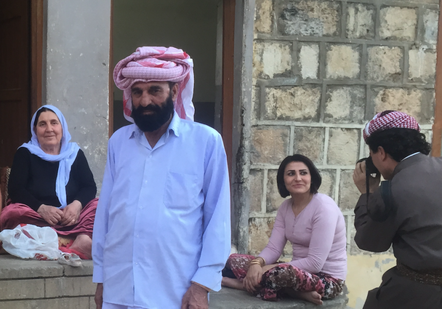 Several Yazidis pose for a photo in Lalish in 2015.